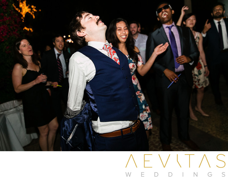Wedding guest taking off jacket at The Houdini Estate