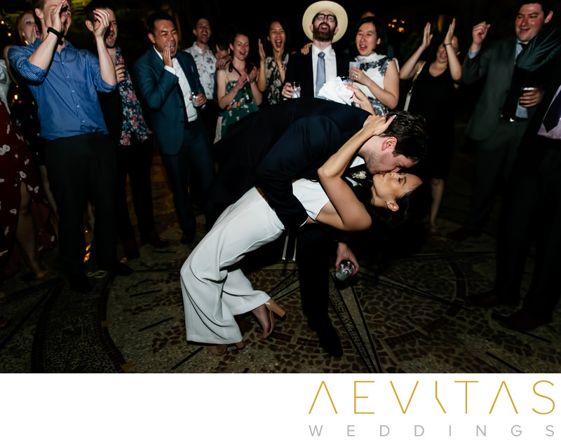 Couple dip on dance floor at The Houdini Estate