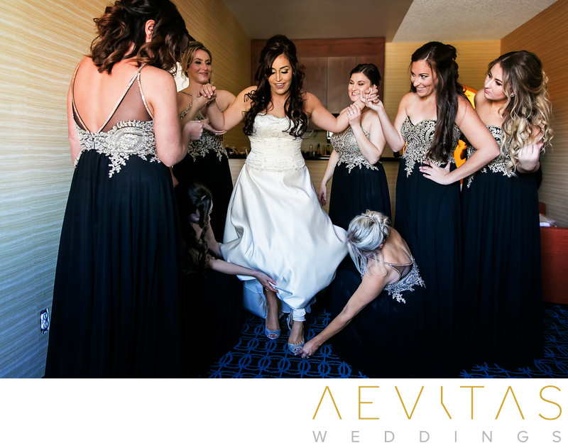 Bride steps into shoes with bridesmaids Anaheim Hills