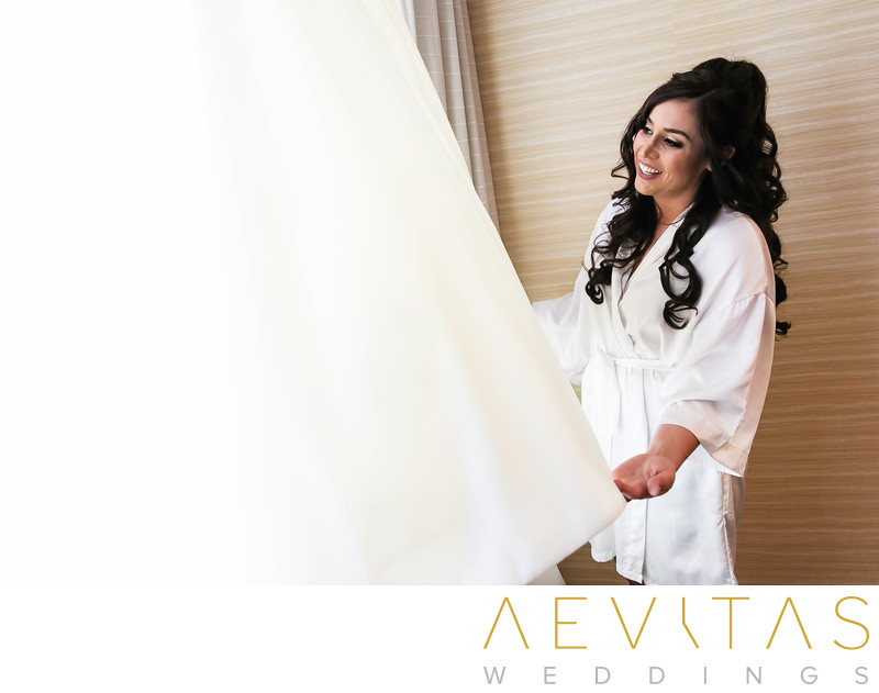 Bride admires dress Anaheim Hills wedding photographer