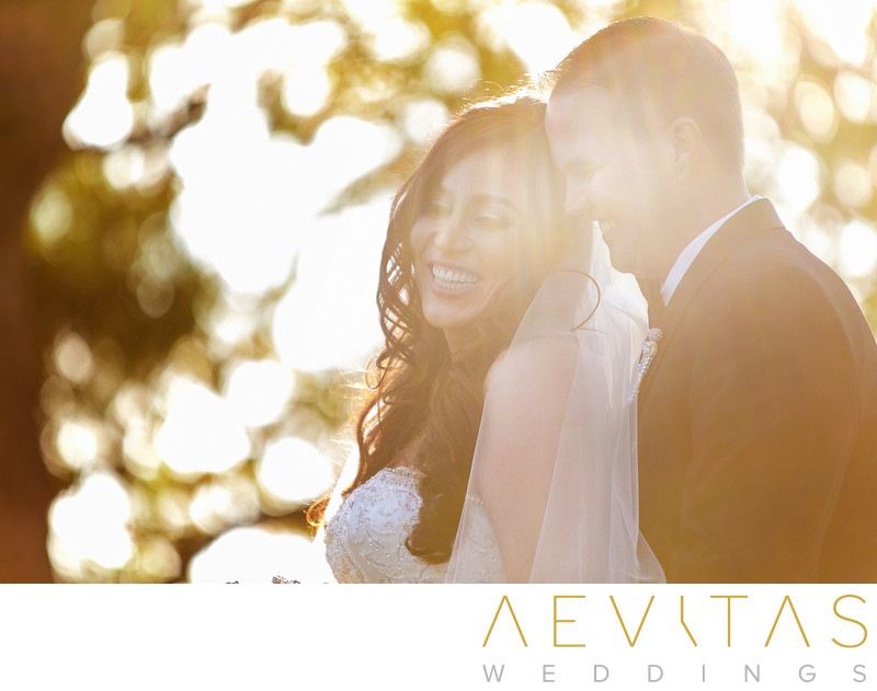 Whimsical portrait of bride and groom smiling in LA