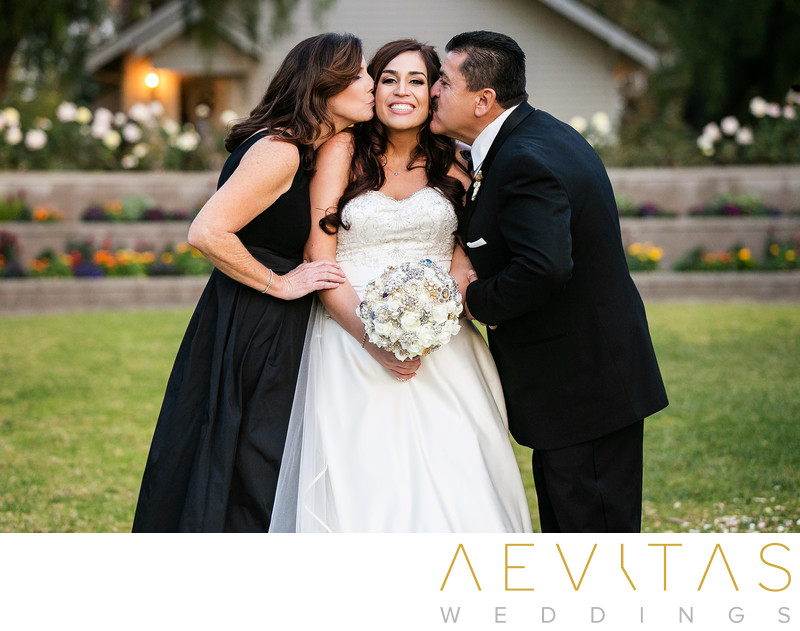 Parents kiss bride photo at Richard Nixon Library