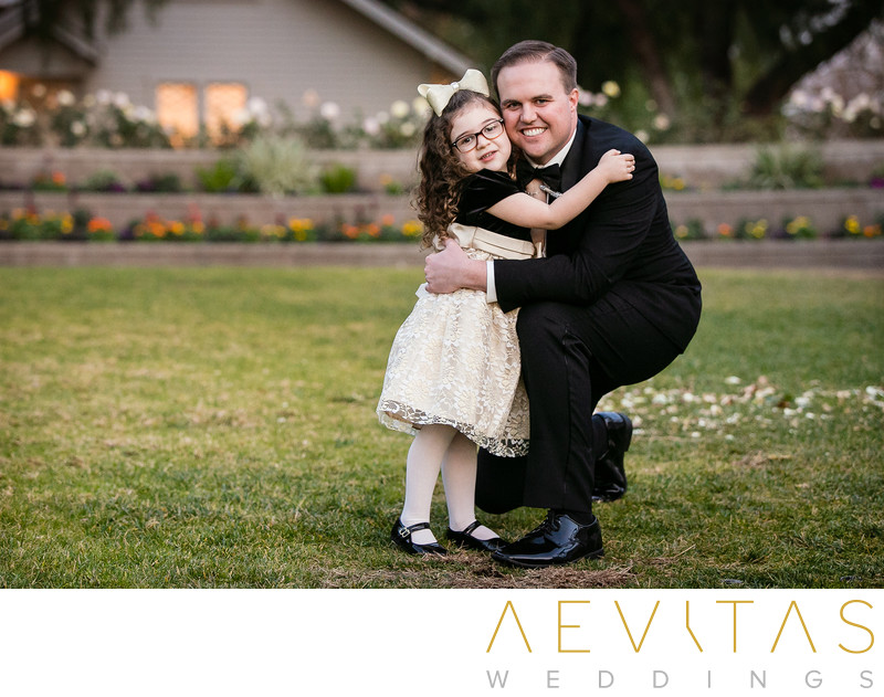 Groom hugging flower girl at Richard Nixon Library