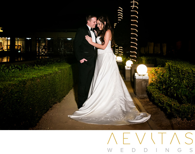 Nighttime couple portrait on garden walkway Yorba Linda