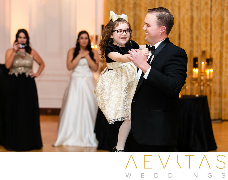Groom dancing with flower girl at Yorba Linda reception