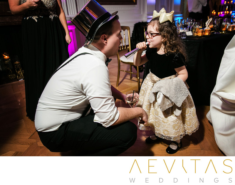 Groom with flower girl at New Year's wedding party