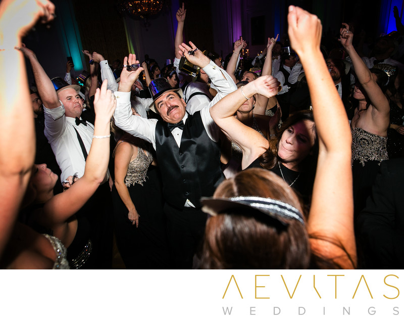 Guests dance with hands in air at Yorba Linda reception