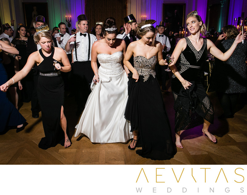Bride dancing with bridesmaids at New Years wedding