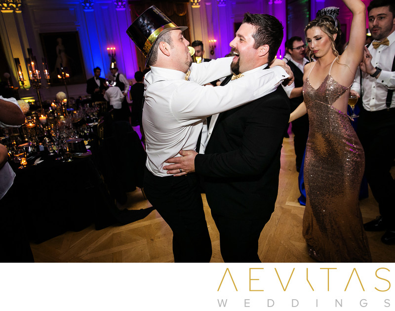 Two men funny moment at New Years Eve wedding