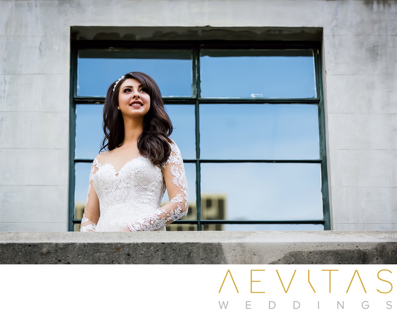 Bride in front of window by LA wedding photographer