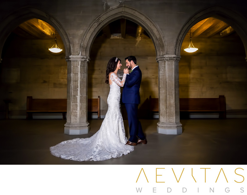 Tender couple moment with archway at LA wedding