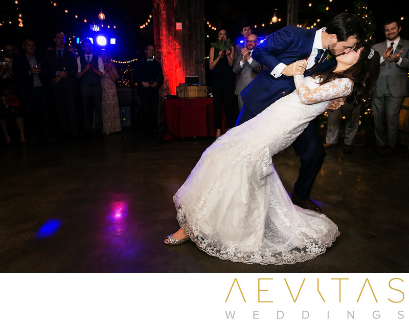 Groom dips bride during Tiato reception first dance