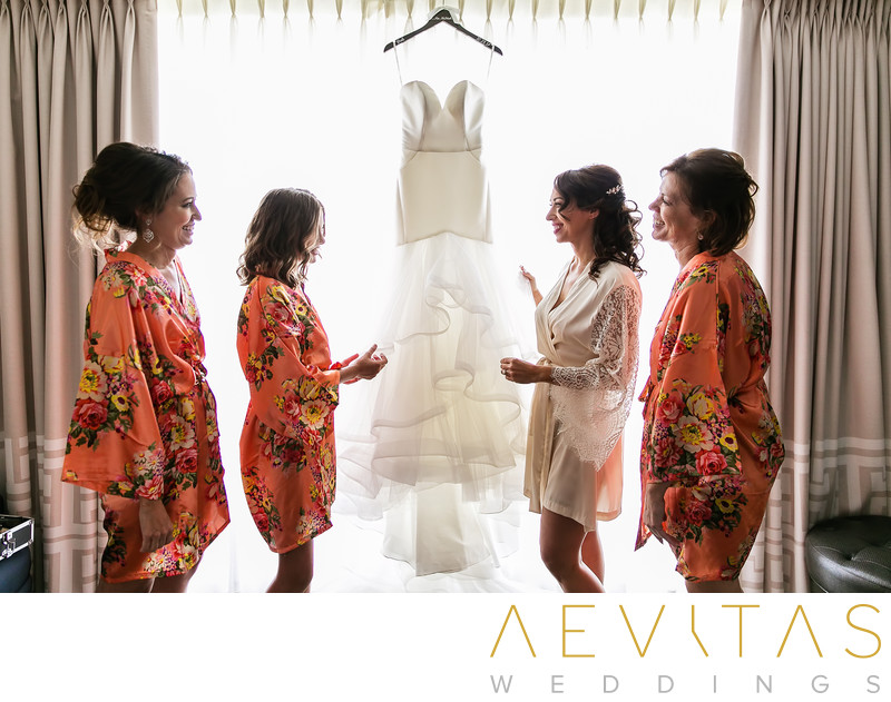 Bride and bridesmaids admiring dress in Santa Monica
