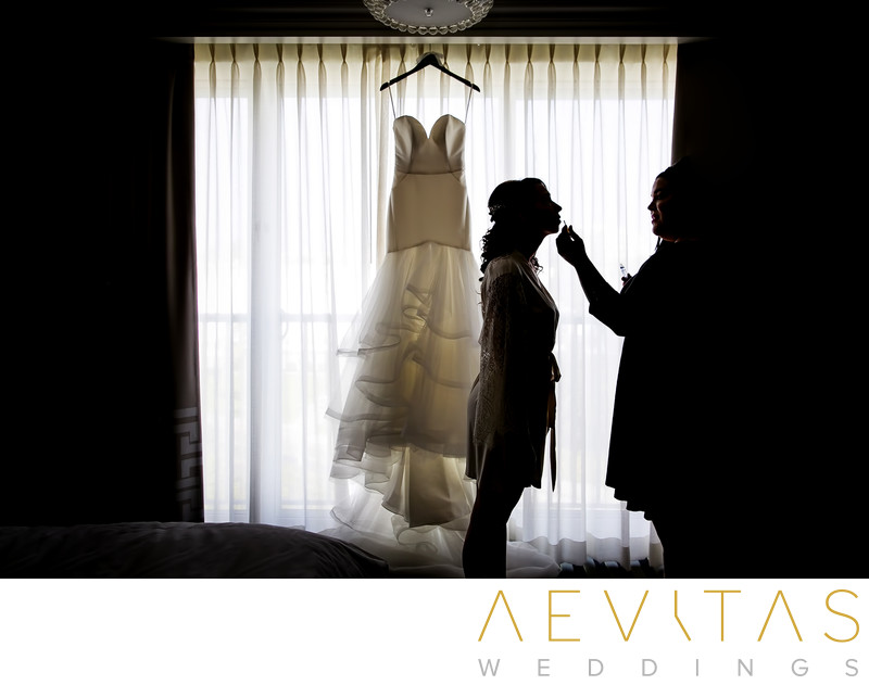 Silhouette bride getting ready with dress Santa Monica