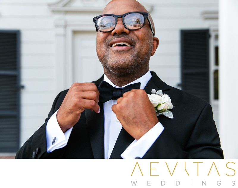 Groom straightens bowtie by Santa Monica photographer