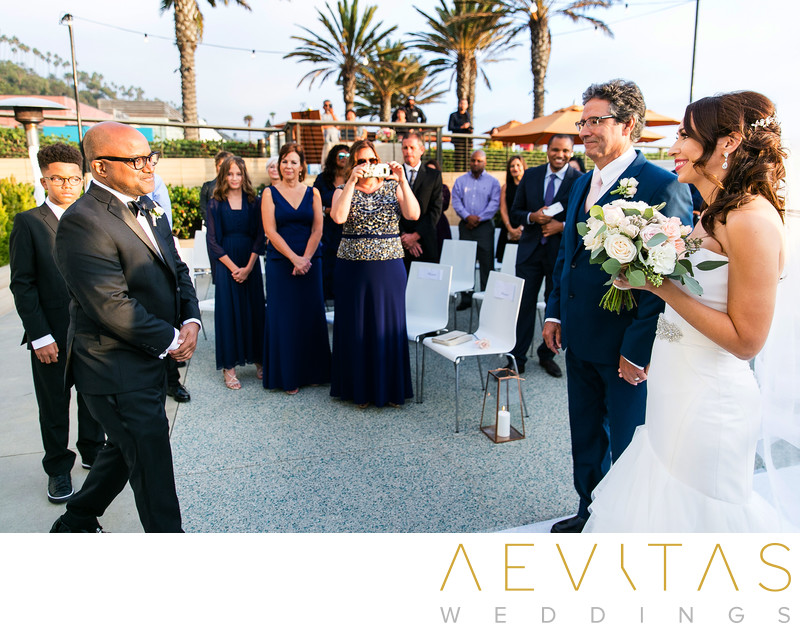 Groom greets bride and father at Santa Monica wedding