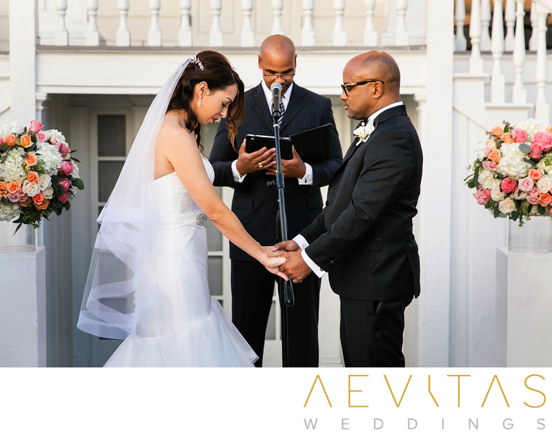 Couple pray at Marion Davies Guest House wedding