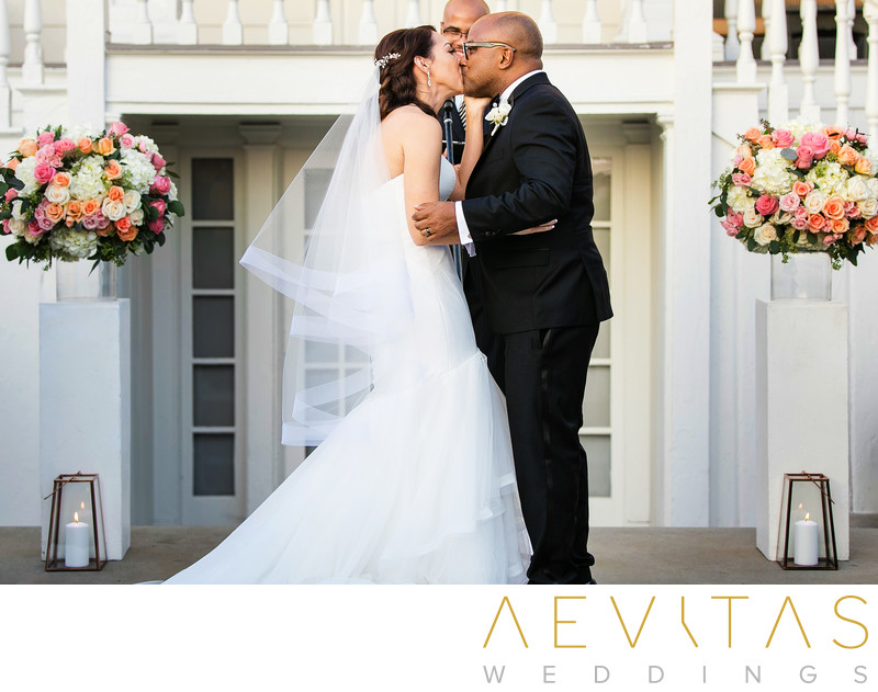 Couple kiss at Marion Davies Guest House wedding