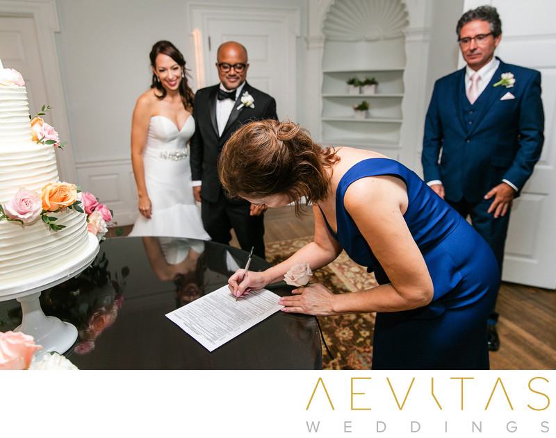 Mother signs marriage license at Santa Monica wedding