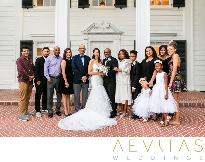 Couple with groom's family at Santa Monica wedding
