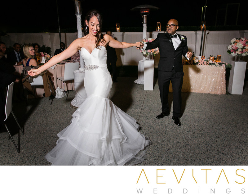 Action shot of couple first dance Santa Monica wedding