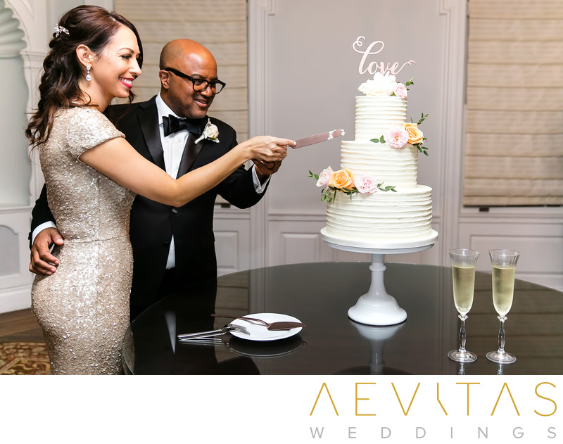 Couple cake cutting at Santa Monica wedding reception