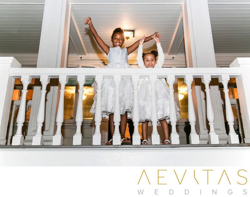 Flower girls on balcony at Marion Davies Guest House