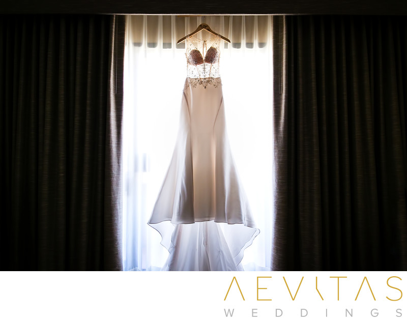 Wedding dress hanging in Hotel Irvine suite window