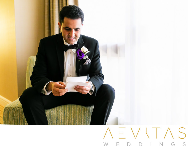 Groom reading notecard from bride Hotel Irvine wedding
