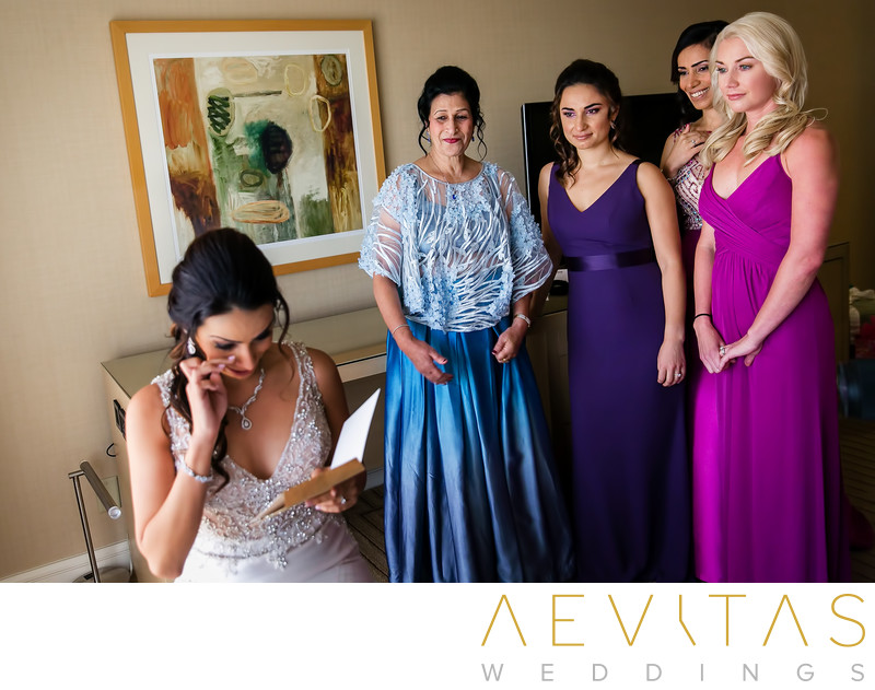 Bride wipes tears while bridesmaids watch on in Irvine