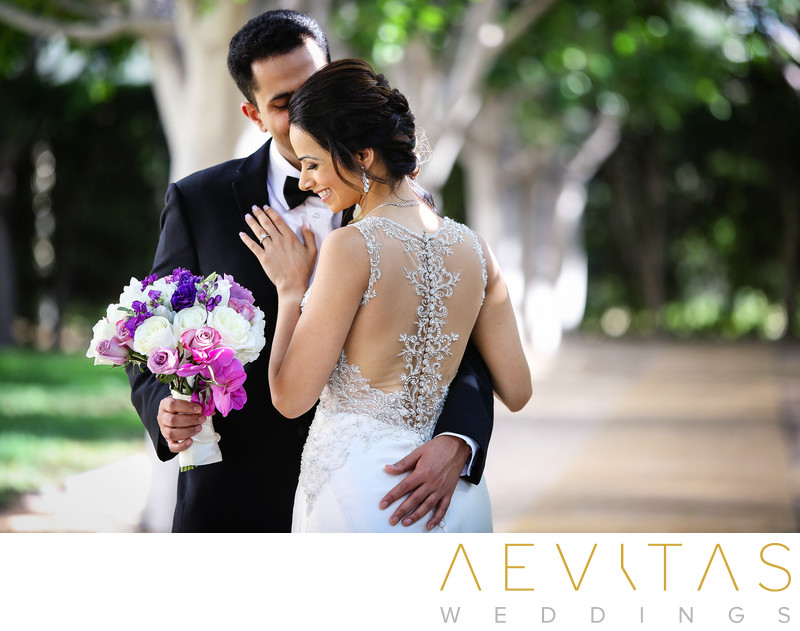 Romantic couple portrait with bouquet at Hotel Irvine