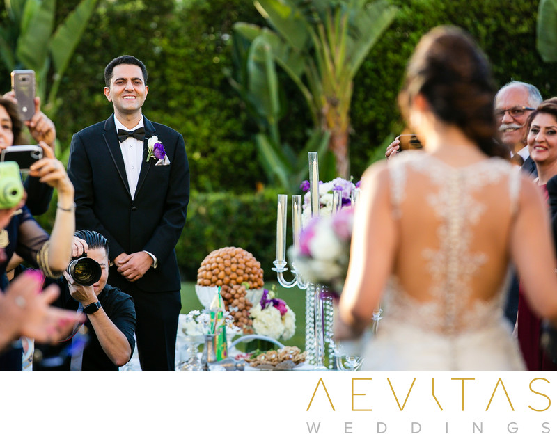 Groom reaction as bride walks down aisle in Irvine