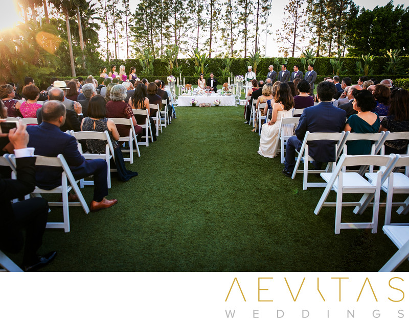 Wide-angle wedding ceremony in Hotel Irvine gardens