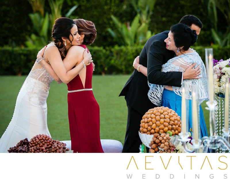 Couple hugs moms at Persian wedding ceremony in Irvine