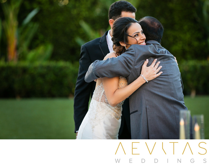 Bride embraces father at Hotel Irvine wedding ceremony