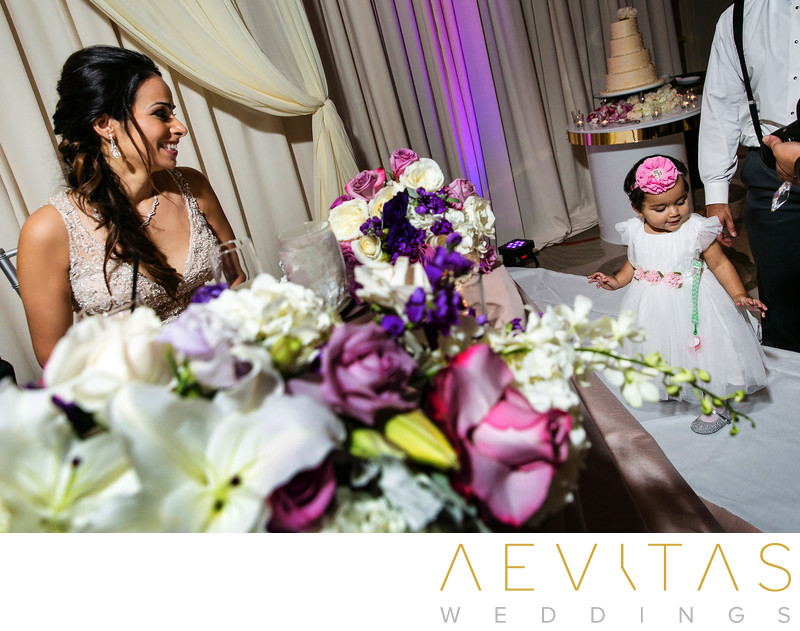 Bride and cute young wedding guest at Hotel Irvine