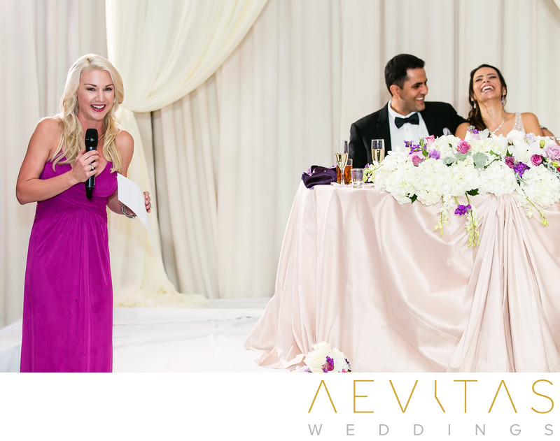Couple laugh at sweetheart table during Irvine speech
