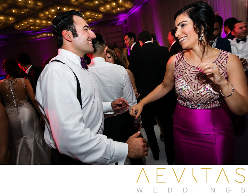 Sister and partner dancing at Persian ballroom wedding