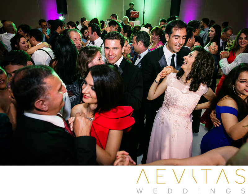 Packed dance floor at Hotel Irvine wedding reception