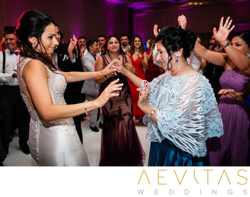 Bride and mom dancing at Persian wedding reception