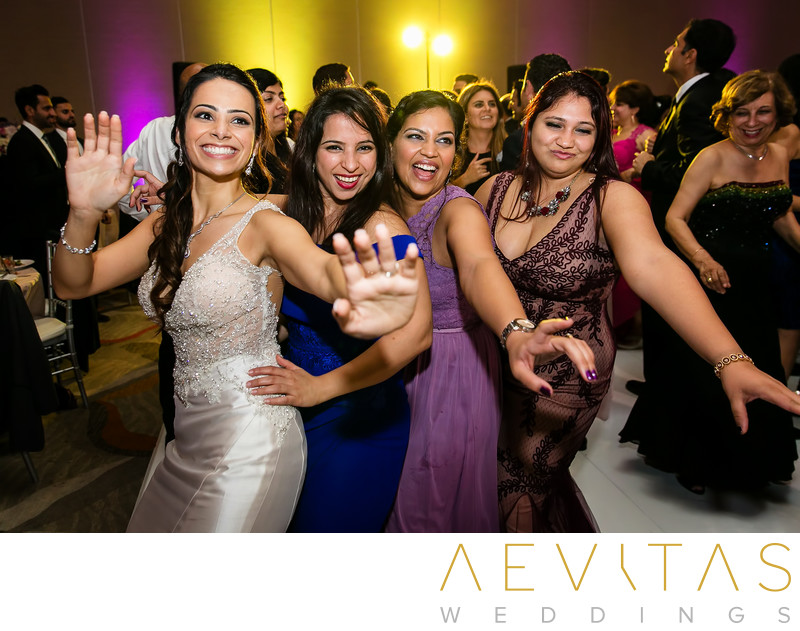 Bride dancing with girlfriends Hotel Irvine reception
