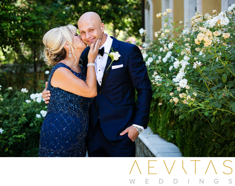 Mom kisses groom's cheek at Arden Hills Resort Club