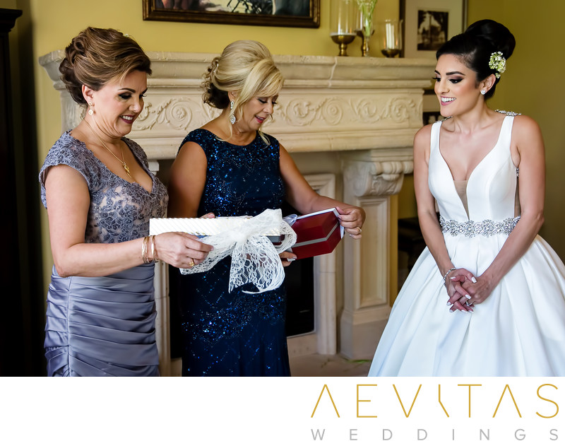 Moms opening gifts with bride at Arden Hills wedding