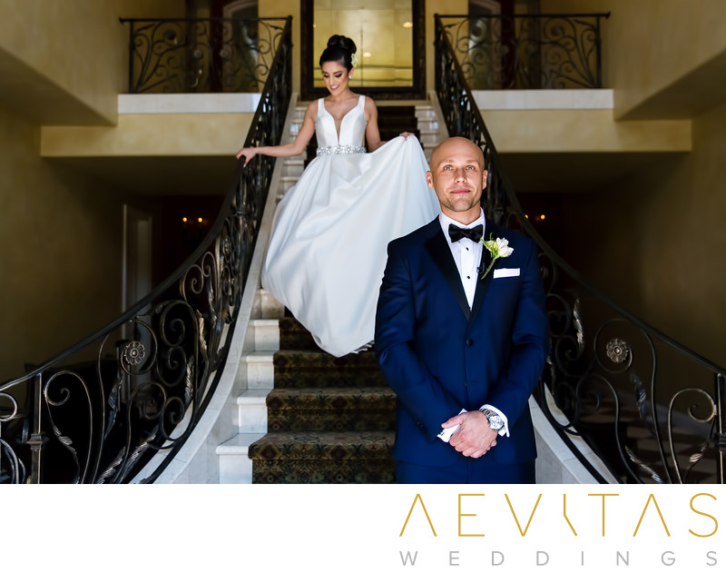 Bride walking down stairs to groom Arden Hills Resort
