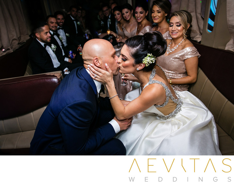 Couple kiss in limo during Sacramento wedding