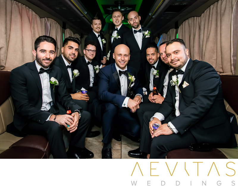 Groom with groomsmen in Sacramento stretched limo