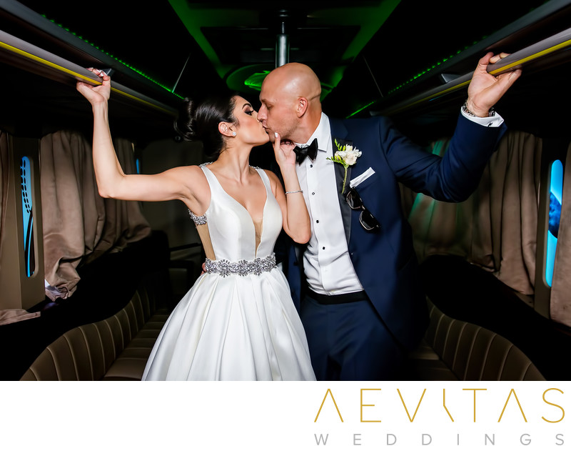 Bride and groom kiss in limo by Sacramento photographer