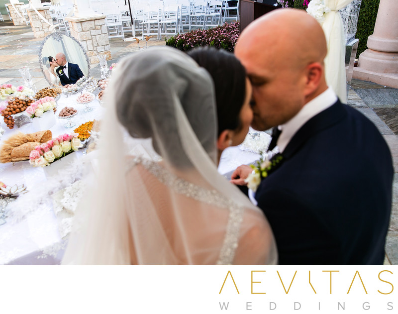 Creative couple kiss with Sofreh table Persian wedding