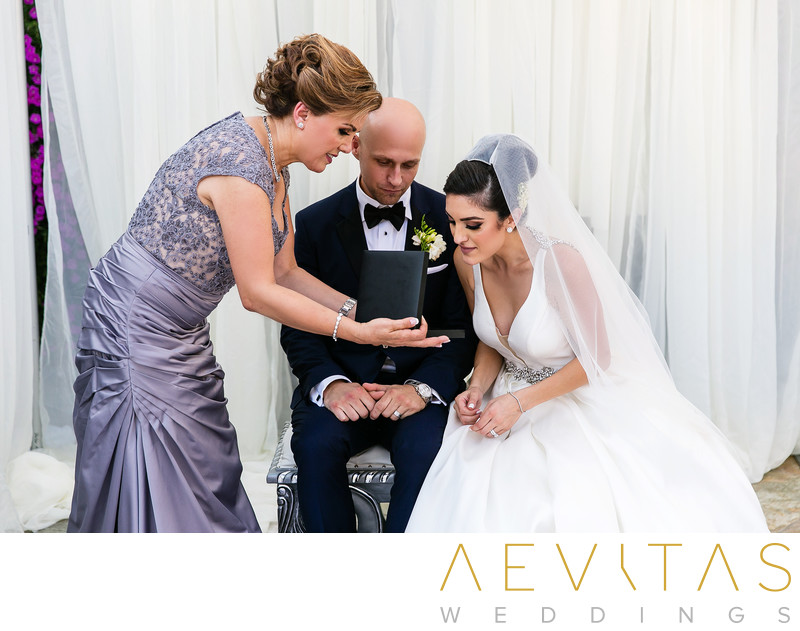 Mother offers jewelry gift to bride Sacramento wedding
