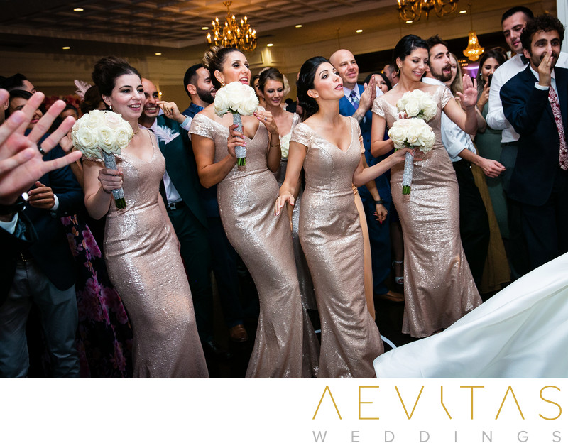 Bridesmaids with bouquets dancing at Arden Hills Resort
